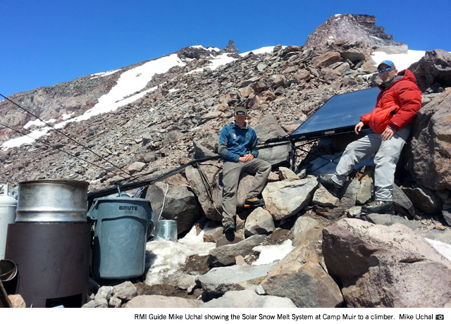 RMI Guide Mike Uchal showing the Solar Snow Melt System at Camp Muir to a climber (Mike Uchal).
